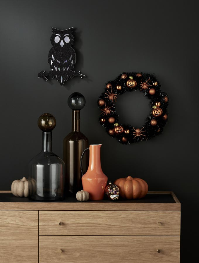 A sideboard decorated for Halloween looking sophisticated but a little spooky too. Image by John Lewis.
