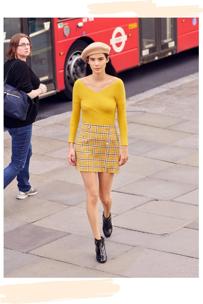 Wow! A yellow knit top looking good with a short yellow tartan skirt. Image by Miss Selfridge.