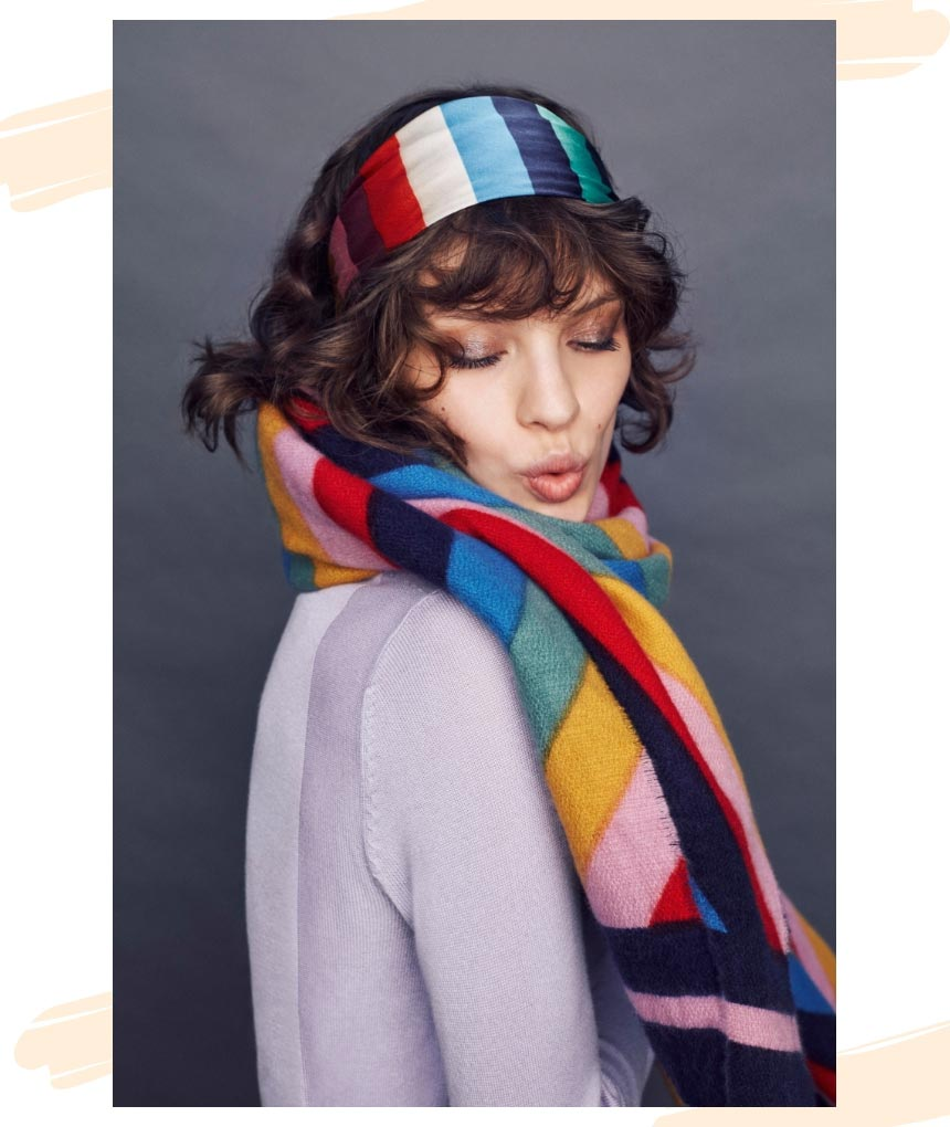 I love that striped knitted headband. Looks so good with that lavender color sweater. Image by Accessorize.