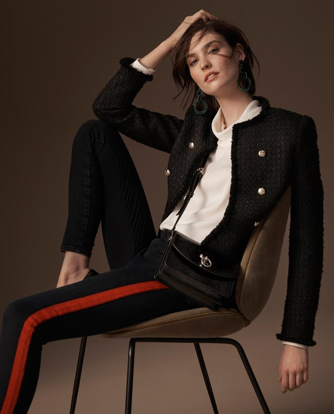 I like this black textured blazer over a white top paired with some track pants. It gives a such a casual vibe but still very elegant. Image by Marks & Spencer.