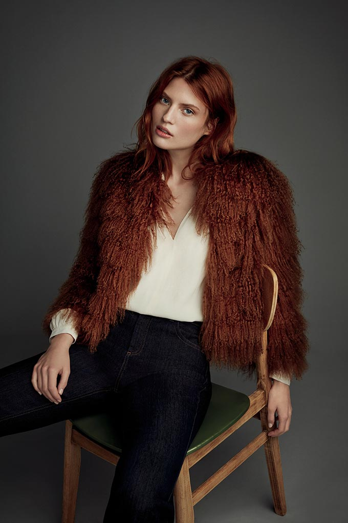 Oh I love this faux fur deep rusty hue jacket over a white top paired with black pants. Makes her look gorgeous. Image by Monsoon.