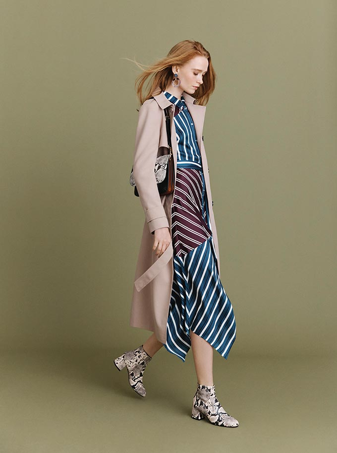 Love this stripe dress with a beige trench coat over it and snake skin ankle boots. Image by Oasis.