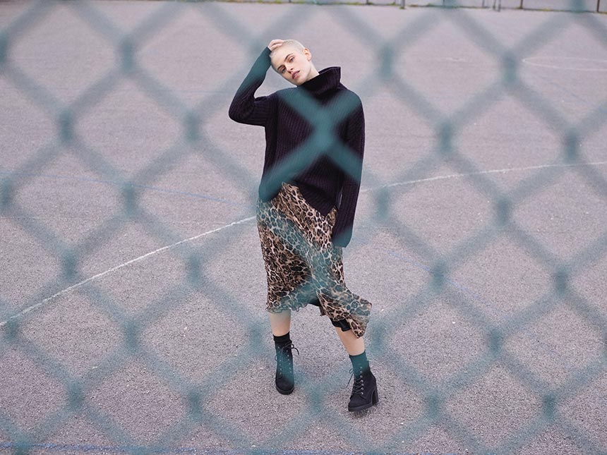 A chunky black sweater can look awfully good with a leopard print skirt. I love her style. Image by Primark UK.