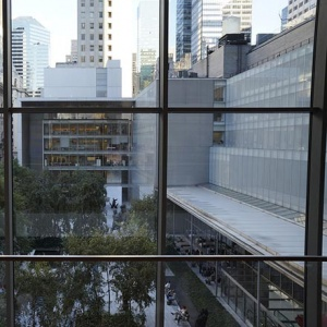Partial view of the Museum of Modern Art in NYC looking from a window inside it.