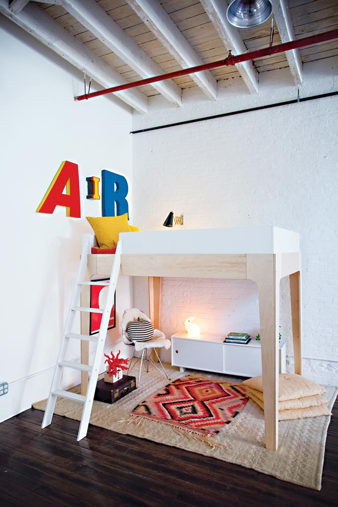 A child's bedroom with a bunk bed and a play area under it. Image by Cuckooland.