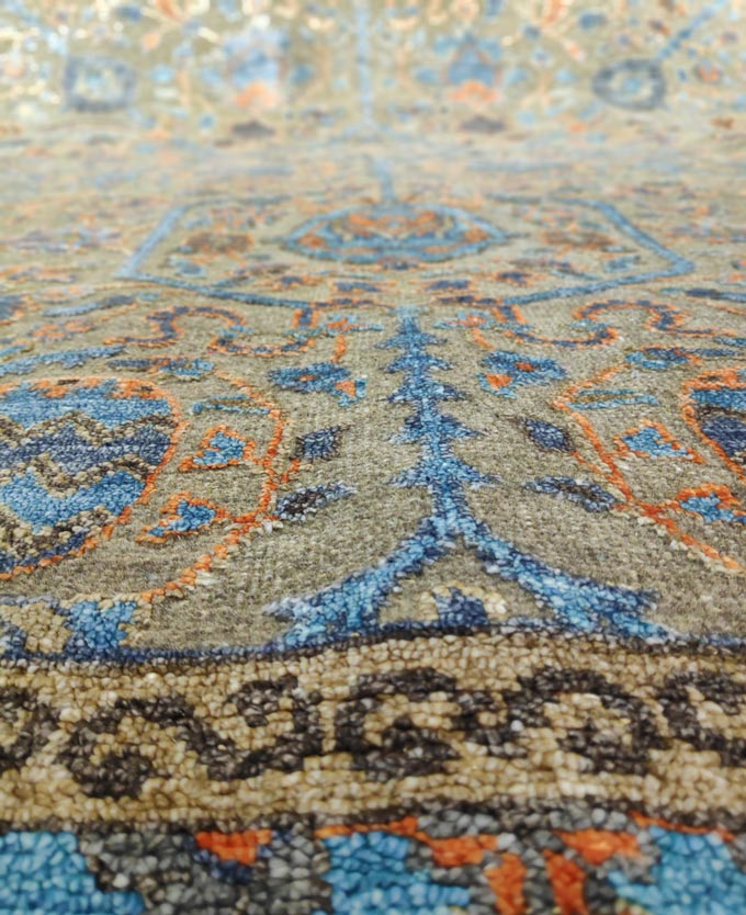 Close up detail of a handmade rug with a pattern. Image by Velvet.