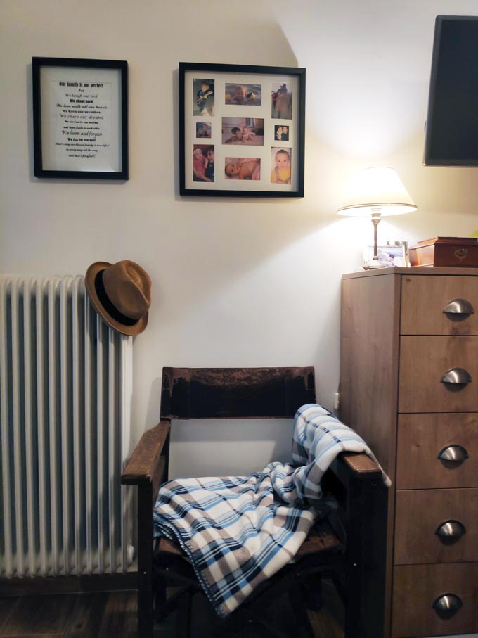 A vignette of Velvet's bedroom with two images on the wall, a director's leather chair and part of my dresser.