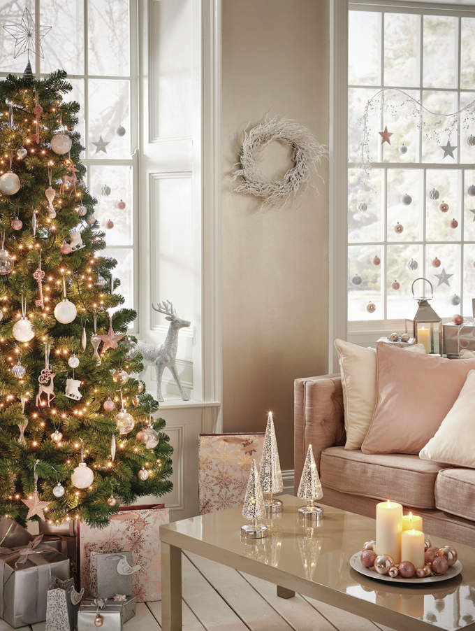 Now blush pink ornaments are not something I've seen before. But it looks great on the Christmas tree in this blush pink living room. Image by Wilco.