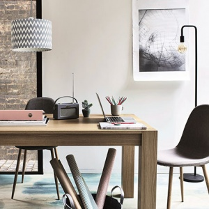 A big desk can provide more than one working stations just like in this space. Image by Argos.