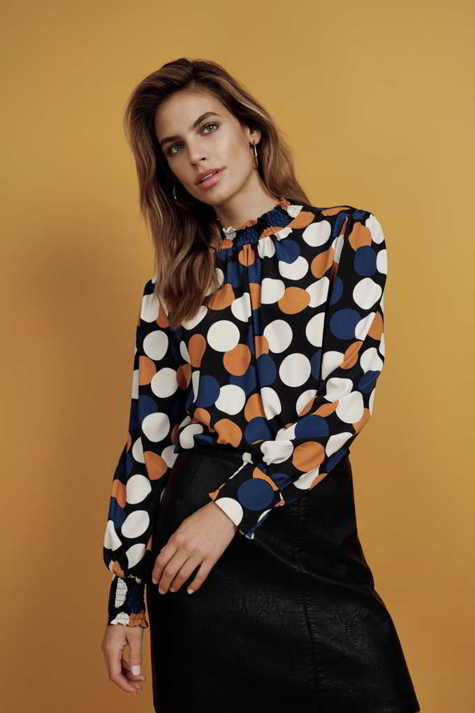Now that is a cool print shirt paired with a black skirt. The colors of spiced honey, blue and white on that shirt really make a huge difference. Image by Dorothy Perkins.