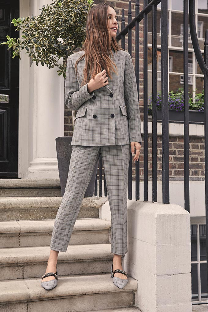 A grey tartan pant suit makes such a great work uniform just like this one. Image by Dorothy Perkins.