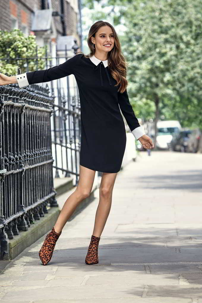 I love this black dress with a white collar paired with leopard print booties. Image by Dorothy Perkins.