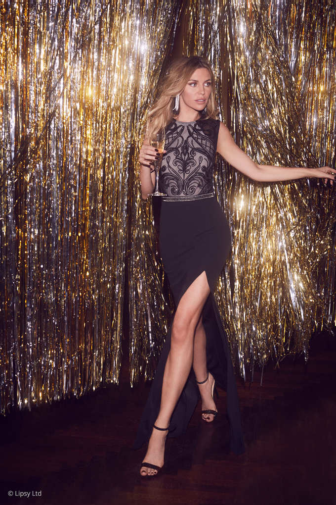A gorgeous black party dress worn by Abbey Clancy. Image by Lipsy.