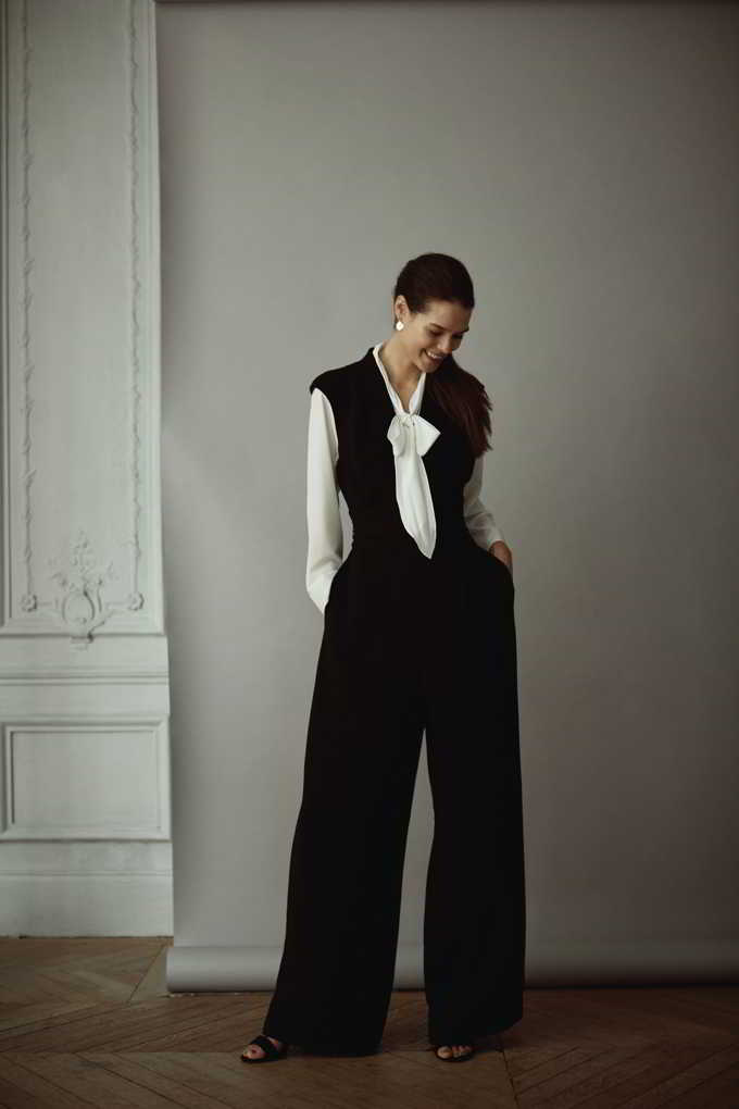 Now this is one of my favorite combos. A white shirt with a black sleeveless vested top and black wide leg pants. So stylish. Image by Matalan.