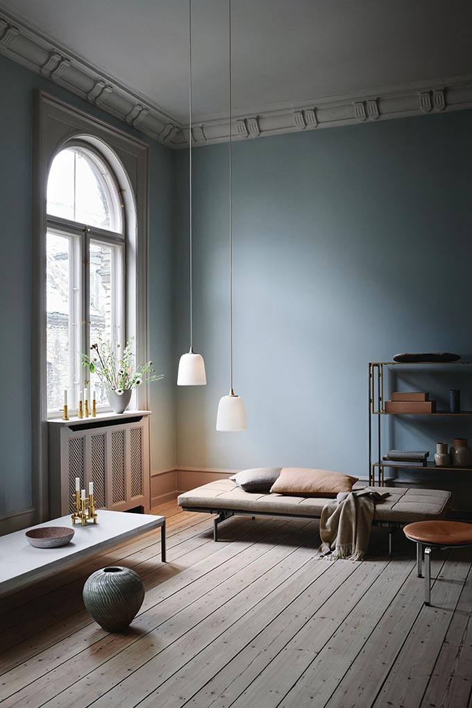 Wow! A Scandi styled living room with light blue walls and a stunning daybed, and two Dogu pendant lights designed for Lightyears looking all so stylish. Image by Nest.