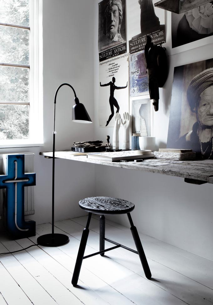 Now that looks like a home office studio that I would like to have with all those images on the wall, a really big tabletop to fit it all and plenty of light coming from the window. The black floor lamp and black stool make it all just perfect. Image by Nest.co.uk.