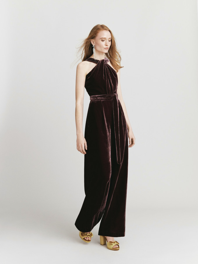 Now that is a very chic dark burgundy velvet playsuit. Love it. Image by Oasis stores.
