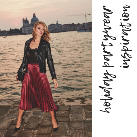 Now this combination is calling my name!! A black leather jacket over a black silk spaghetti strap top paired with a burgundy long pleat skirt and black pumps! Wow! Venice cityscape appears in the background. Image by Sosandar.