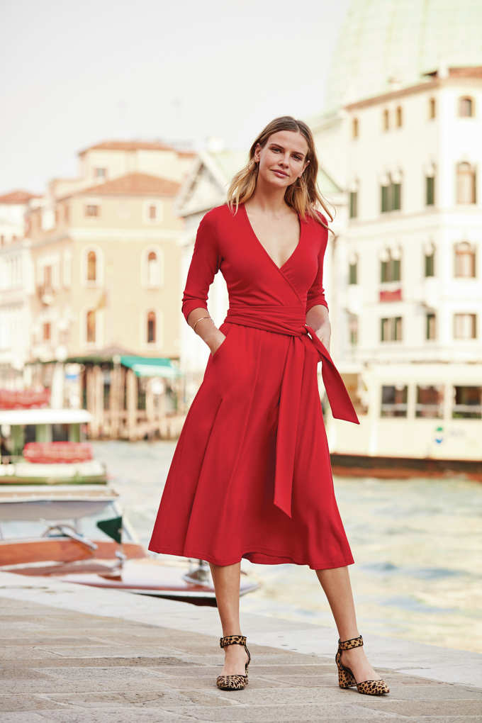 I love this faux red wrap dress with a belt combined with leopard print shoes. Image by Sosandar.