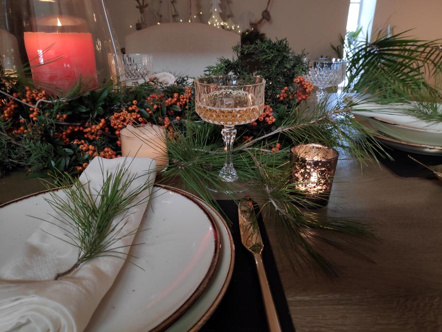 View of three sets from Elisabeth's Christmas tablescape.