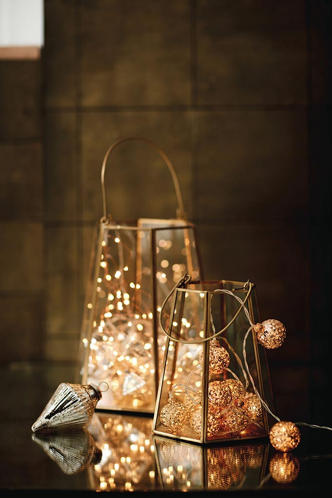 Two lanterns with fairy lights in them. Image by Marks & Spencer.