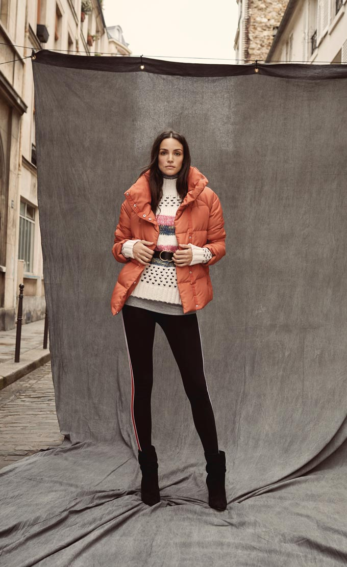 I love this whole outfit: coral puffed jacket, sweater and leggings. Image by Matalan.