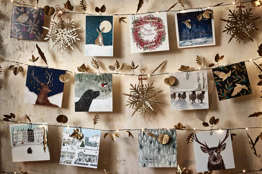 The strings with Christmas lights and Christmas cards hanging from them. What a wonderful decorating idea. Image by National Trust.