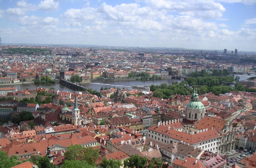 Partial view of Prague with the Vltava river meandering through it.