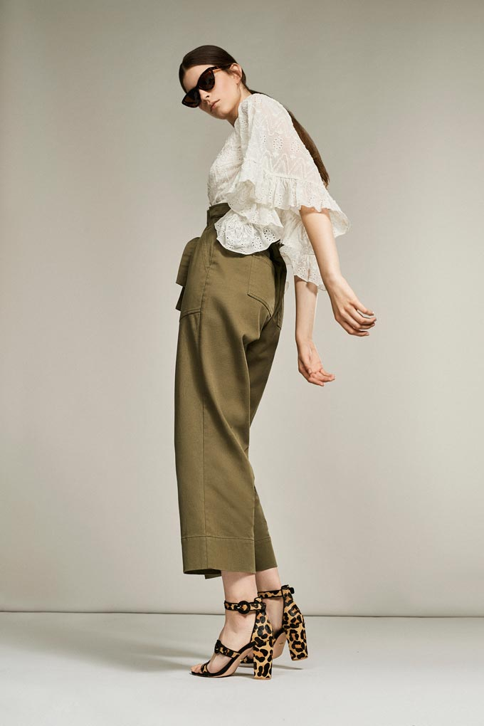 An off-white top with some broderie paired with some khaki high waist pants and leopard print shoes. Looking good! Image by Debenhams.