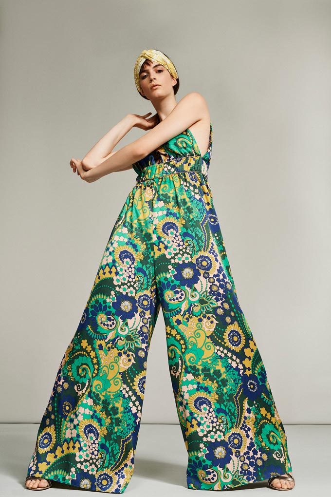 A really wide jumpsuit with a very vivid print in green mostly is surely a head-turner. Image by Debenhams.