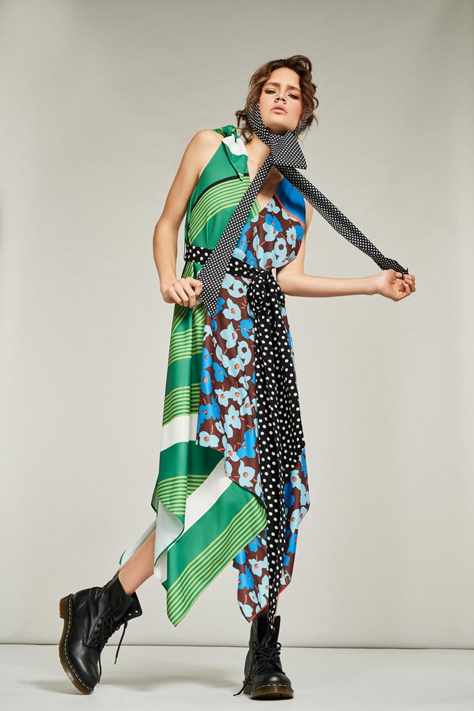 That's an interesting spring dress with lots of different print clashes - florals, prints and polka dots all in one with green and blue hues predominantly. Image by Debenhams.