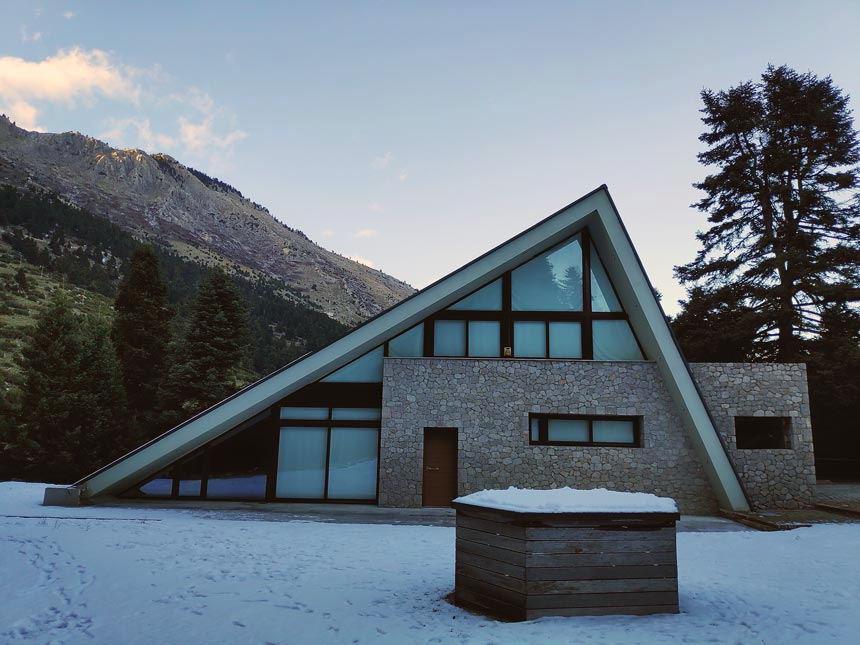 View of the front facade of a stunning chalet in Greece.