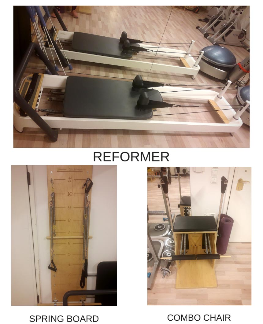 Three of the most basic Pilates apparatus: the reformer, the combo chair and the spring board.