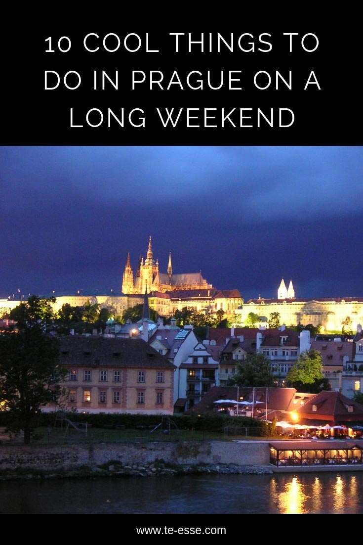 A pin graphic with an image of Prague at night. This is a guide to the city on a long weekend break.