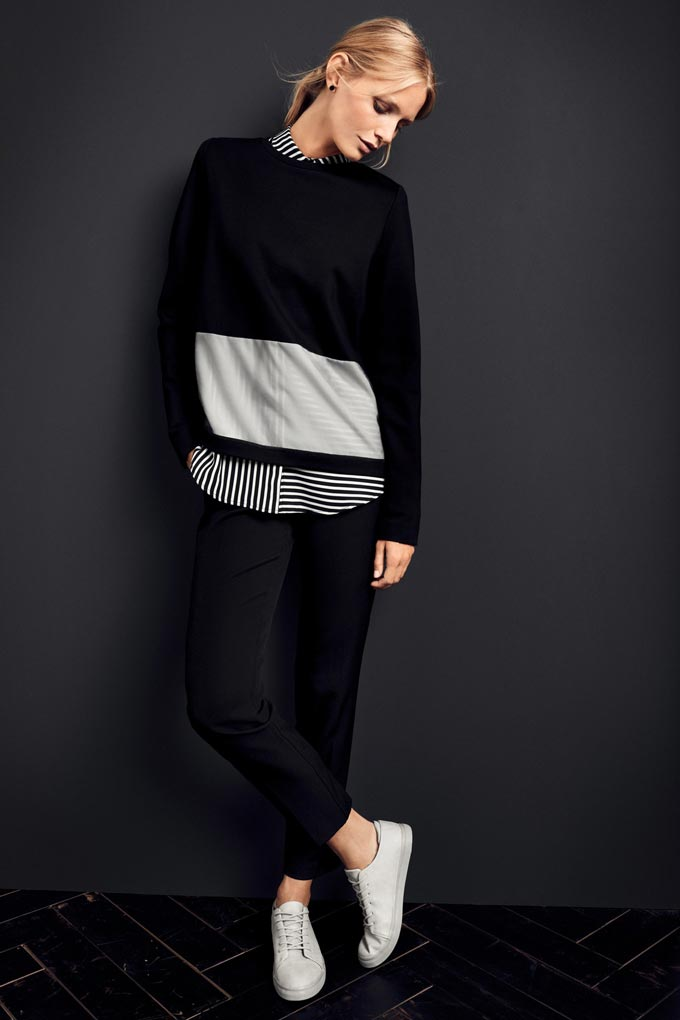 I love a striped shirt under a black and white top paired with black pants and white kicks. Image by Betty & Co.