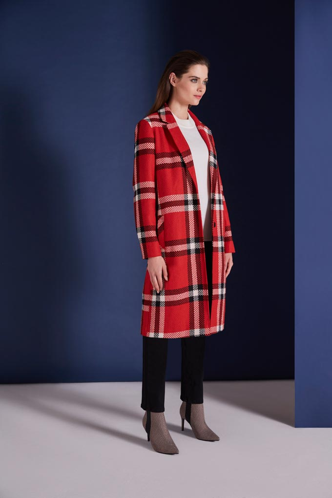 A red check coat looks stunning with a white blouse under it and black pants over a very thin stripe print ankle boot. Image by Bonmarche.
