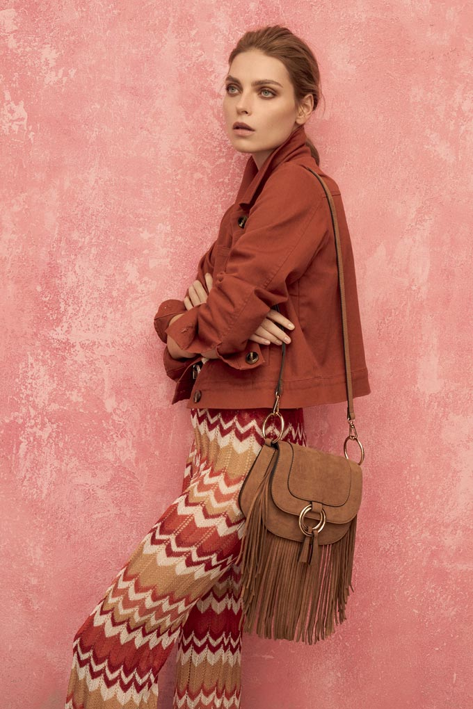 Rusty hues are hot. Love those pants with a chevron pattern, the rusty hue jacket and fringed leather bag. Image by Dorothy Perkins.