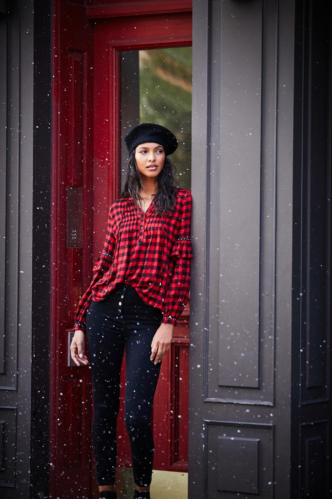 A red check shirt over black denims and a black beret hat oozes a bit of French style, doesn't it? Image by Matalan.