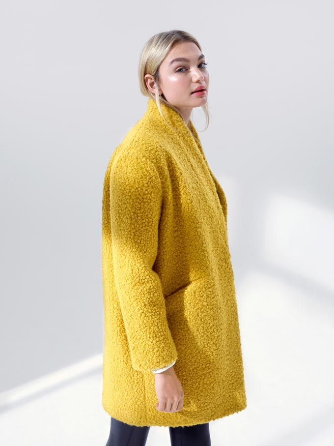 A yellow shearling coat might be the best buy for this upcoming new season. Image by Miss Selfridge.