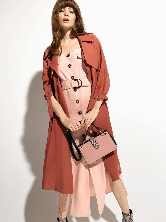 A rusty colored trench coat over a soft blush pink button down dress is always a good match. Image by Miss Selfridge.