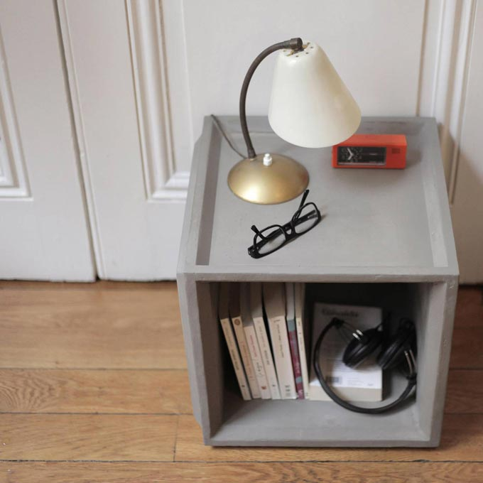 A storage unit made of concrete that can easily serve as a nightstand too. Image by Lime Lace.