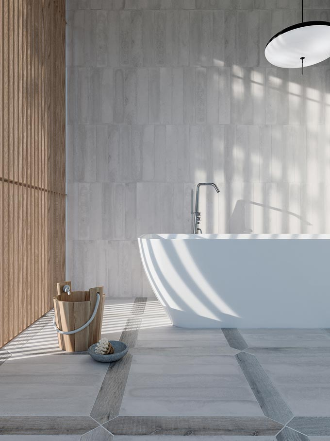 A large white contemporary tub on cement like tiles by WOW Design. The wooden slats on the left filter the sunlight while creating a really Zen feeling. Image by WOW Design.
