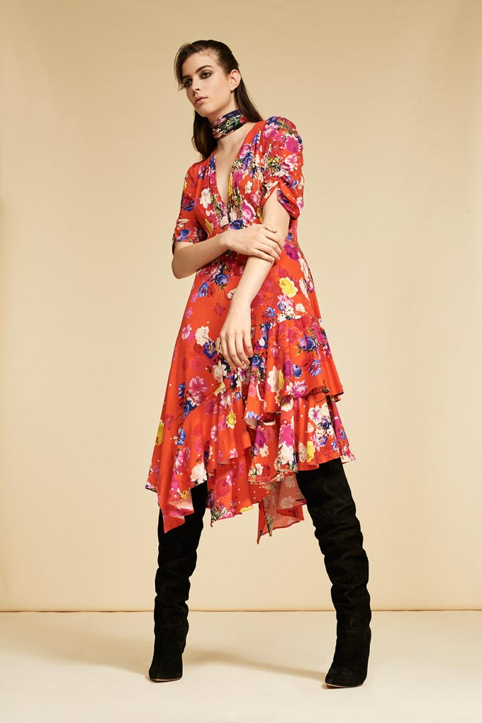 I love this red floral print dress with easy going flares styled with knee high black boots. Image by Debenhams.