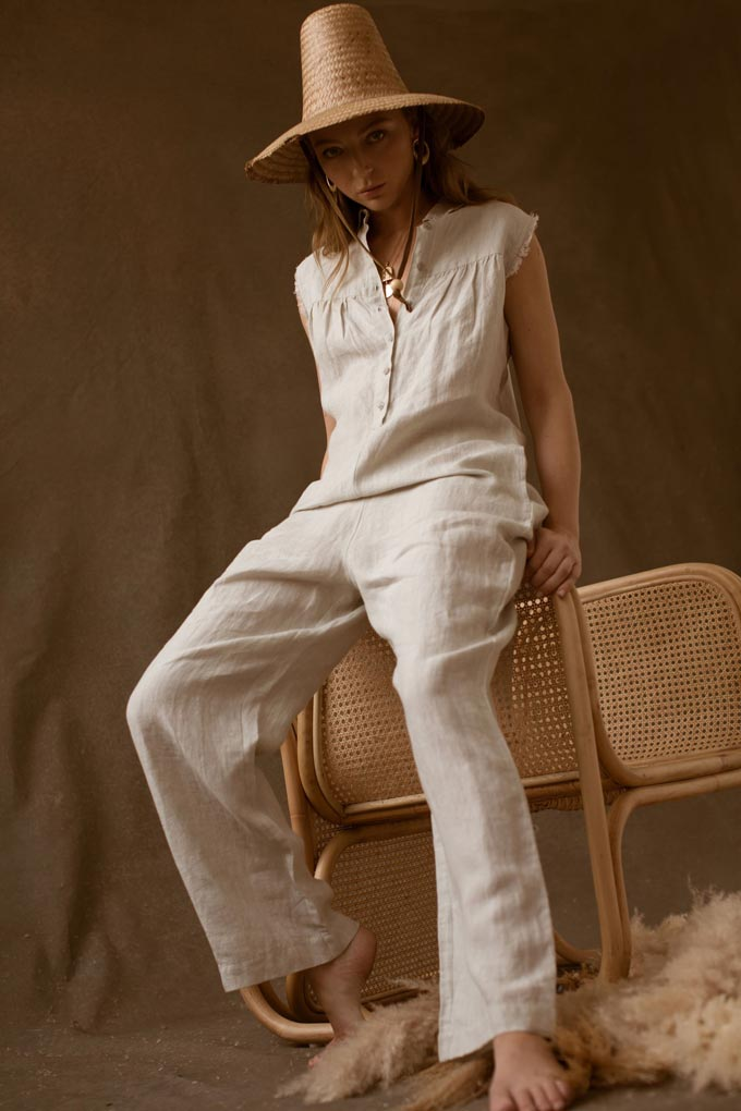 A sleeveless jumpsuit made of linen by Made With Respect.