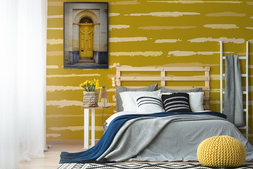 Teen bedroom decorating ideas: A mustard wall mural looking awesome in a contemporary bedroom. Image by Pixers.
