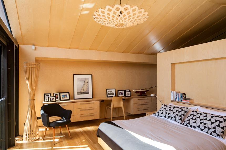 A beautiful bedroom with a David Thubridge pendant lighting, lots of light wood accents. Image by David Thubridge.