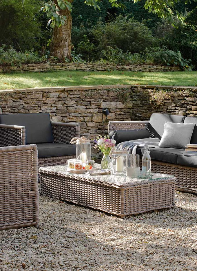 That's my kind of style of outdoor wicker patio furniture. Image by Garden Trading.