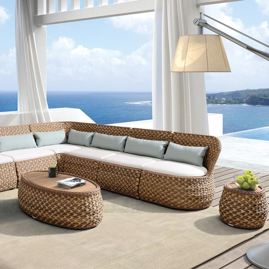 Imagine a covered outdoor space with a sea view and a rattan corner sofa on the deck with a coffee and side tables just like this one. Wow. Image by Image by Sweetpea & Willow.