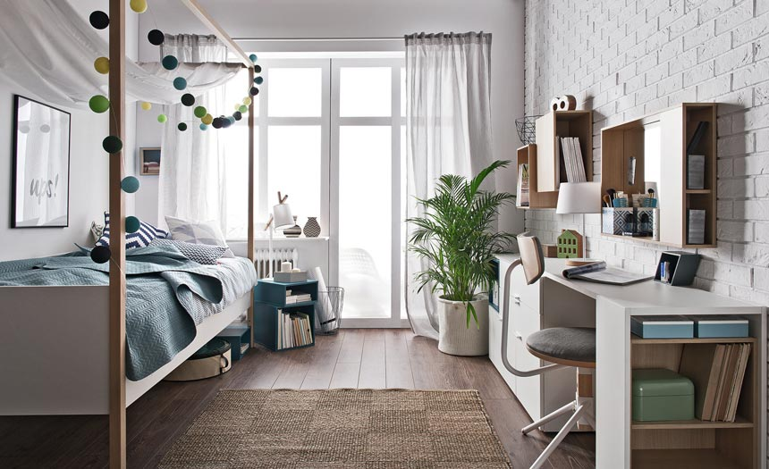 A teen's bedroom with some blue accents but white furniture. Image by Cuckooland.