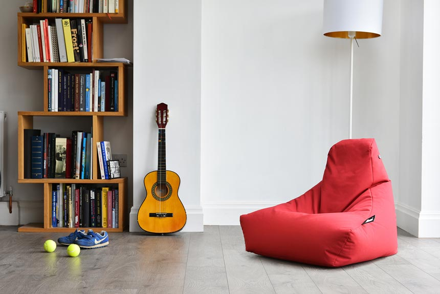 A red bean bag, a guitar and a bookcase filled with books are all things you should expect to see in a teen's bedroom. Image by Cuckooland.